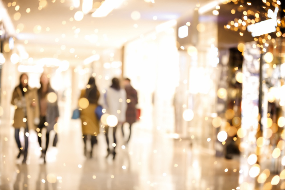 Blurred image of shoppers and lights.