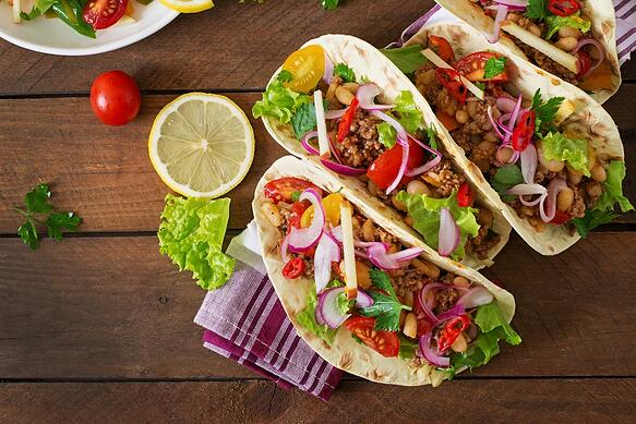 Overhead image of tacos on a table.
