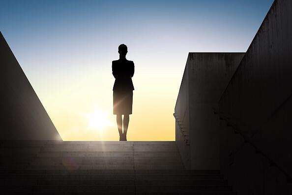 Silhouette of a woman facing the sun.