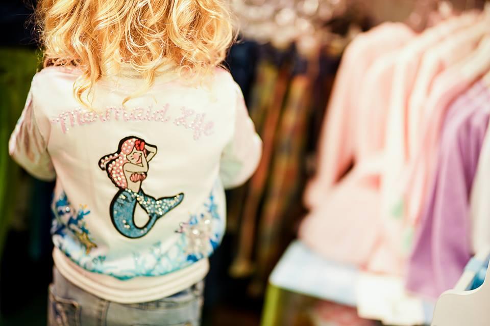 little girl wearing a mermaid life rhinestone jacket