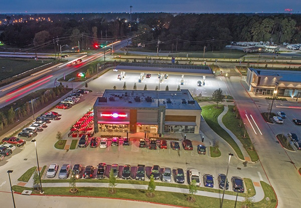Overhead shot of restaurant and parking lot.