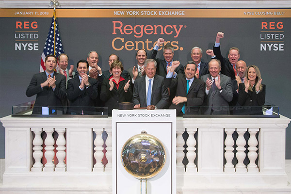 Regency Centers employees ringing in the day at the stock exchange.