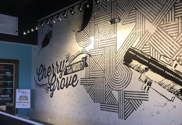 Black and white wall art inside a Mod Pizza restaurant