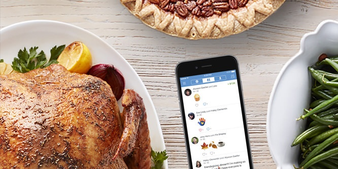 A turkey, green beans, a pecan pie and an iPhone on a table.